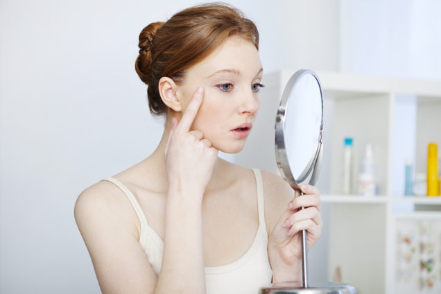 San Diego Cosmetic Laser Center - Young Woman Looking at Crow's Feet